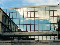 Stick system curtain wall / aluminum / glass / with integrated insulation