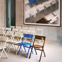 Contemporary chair / folding / stackable / polypropylene