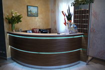 Semicircular reception desk / wooden