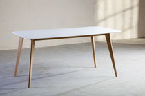 Contemporary table / wooden / Corian® / for public buildings