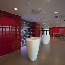 Semicircular reception desk / Corian®