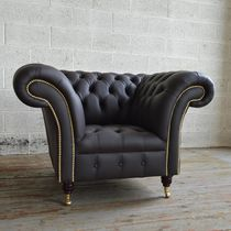Chesterfield armchair / leather / on casters / brown