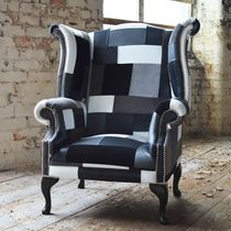 Chesterfield armchair / fabric / leather / wing