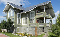 Prefab house / traditional / glue-laminated wood / energy-efficient
