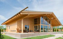 Prefab house / contemporary / glue-laminated wood / energy-efficient