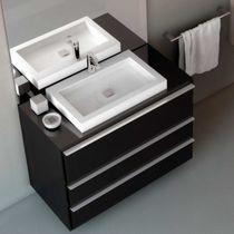 Countertop washbasin / rectangular / ceramic / Corian®