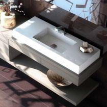 Wall-mounted washbasin / rectangular / ceramic / Corian®