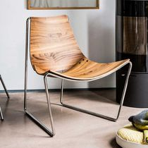 Contemporary fireside chair / walnut / steel / sled base