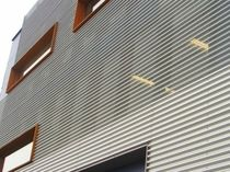 Sheet metal cladding / ribbed / panel