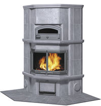 Wood heating stove / traditional / stone / corner