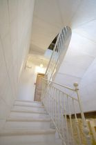 Quarter-turn staircase / stone steps / metal frame / with risers