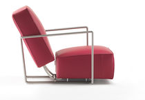 Contemporary armchair / fabric / metal / leather