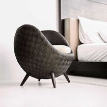 Contemporary armchair / rattan / maple / with footrest