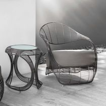 Contemporary armchair / rattan / polyethylene / steel