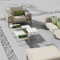 Contemporary armchair / rattan / ash / aluminum