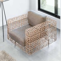 Contemporary armchair / rattan / steel / stainless steel