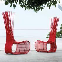 Original design chair / rattan / steel / PVC