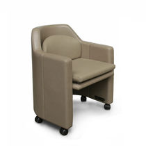 Contemporary visitor armchair / leather / steel / on casters