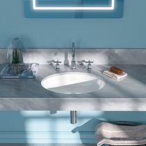 Undercounter washbasin / oval / ceramic / contemporary