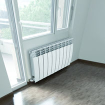 Hot water radiator / horizontal / aluminum / wall-mounted