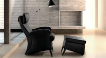 Contemporary armchair / leather / with footrest