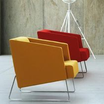 Contemporary armchair / polyurethane / sled base