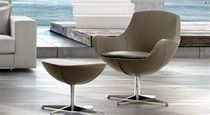 Contemporary armchair / leather / metal / with footrest