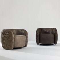 Original design armchair / fabric / leather / swivel