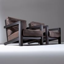 Contemporary armchair / wooden / fabric / leather