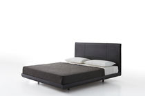 Double bed / contemporary / leather / with upholstered headboard