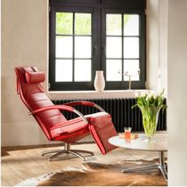 Contemporary armchair / fabric / leather / with armrests