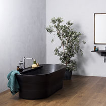 Free-standing bathtub / oval / natural stone
