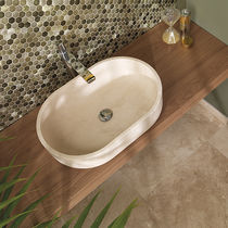 Countertop washbasin / oval / natural stone / contemporary