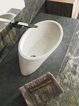 Countertop washbasin / round / natural stone / contemporary