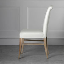 Contemporary chair / upholstered / solid wood / leather