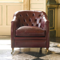 Chesterfield armchair / fabric / leather / on casters
