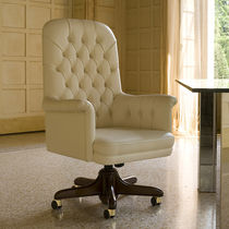 Chesterfield executive chair / leather / on casters / swivel