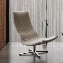 Contemporary armchair / leather / with footrest / swivel