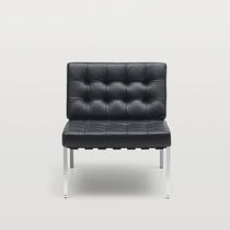 Contemporary visitor armchair / leather / steel / modular