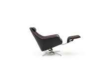 Contemporary armchair / leather / tilting / with footrest