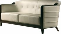 Contemporary sofa / leather / cherrywood / fabric
