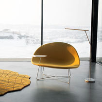 Contemporary fireside chair / fabric / leather / black