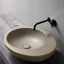 Countertop washbasin / oval / ceramic / original design