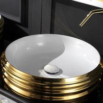 Countertop washbasin / round / ceramic / original design
