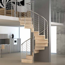 Spiral staircase / wooden steps / metal frame / with risers