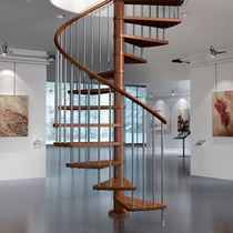 Spiral staircase / wooden steps / wooden frame / without risers