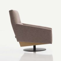 Contemporary armchair / fabric / swivel / with footrest