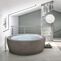 Free-standing bathtub / round / composite / double