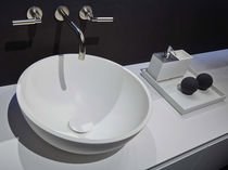 Countertop washbasin / round / Corian® / contemporary
