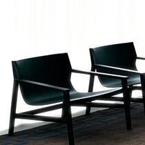 Contemporary fireside chair / walnut / by Piero Lissoni